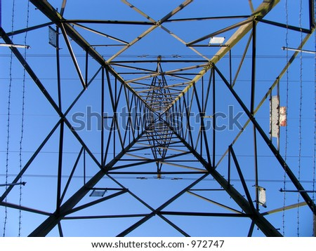 An electricity pylon from below - nice geometric shapes - stock photo