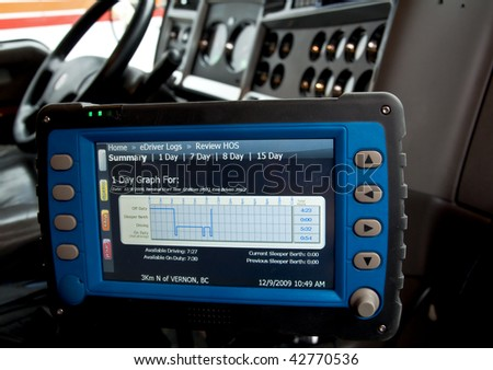 An electronic logbook for truck drivers keeps track of the hours of service. - stock photo