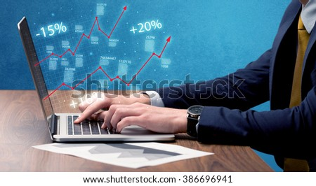An elegant businessman working on graph statistics calculation using a laptop with clear blue background concept - stock photo