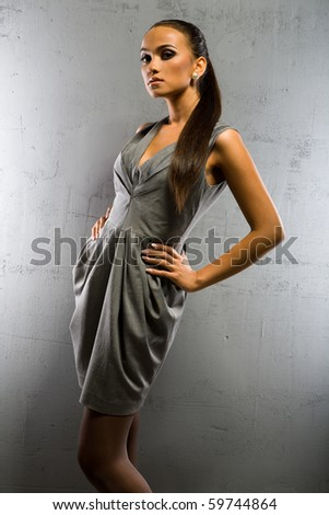 an elegant girl in grey dress - stock photo