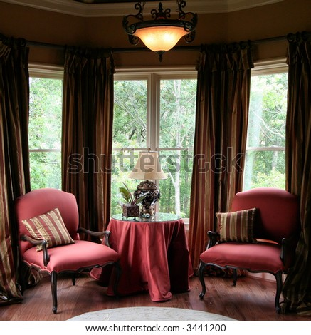 An elegant indoor seating and reading area. - stock photo
