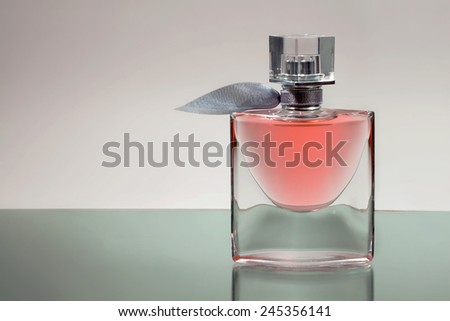 An elegant perfume bottle on mirror