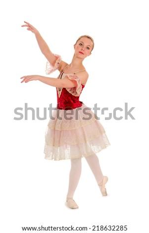 An Elegant Teenage Student Ballerina in Red Spanish Recital Costume - stock photo