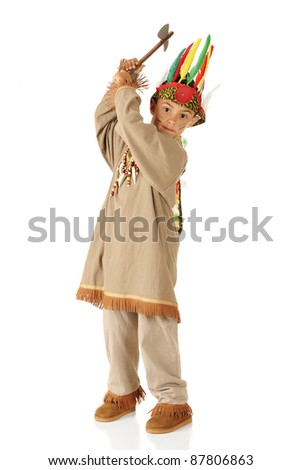 """An elementary boy playing """"Indian"""" in costume and with raised tomahawk.  On a white background. - stock photo"""