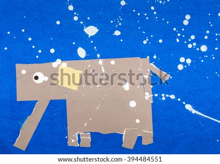 An elephant walking in the night under stars - stock photo