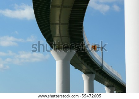 An elevated highway and a blue sky - stock photo