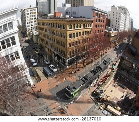 An elevated view of downtown Portland, OR. Public transportation runs through the business district. - stock photo