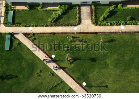 an elevated view of people walking in the garden - stock photo