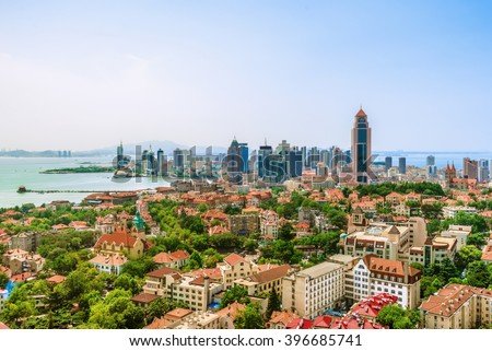 An Elevated view of Qingdao Skyline. Villa and Office Buildings, Skycarper near the sea. Qingdao is a famous tourist city in east China. - stock photo