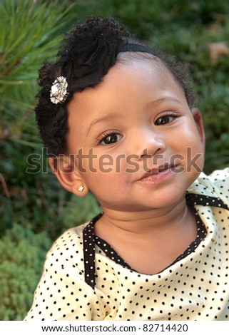An eleven month old female baby smiles - stock photo
