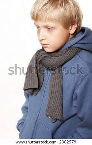 An eleven year upset boy Background is white. - stock photo