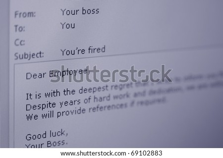 An email from a boss to his/her employee informing him/her that he/she has been fired. - stock photo