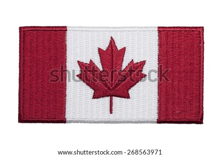 An embroidered Canadian flag patch isolated on a white background. - stock photo