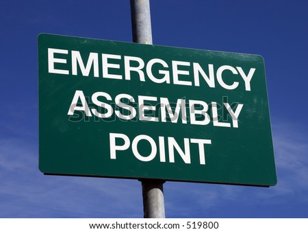 An emergency assembly point sign. - stock photo