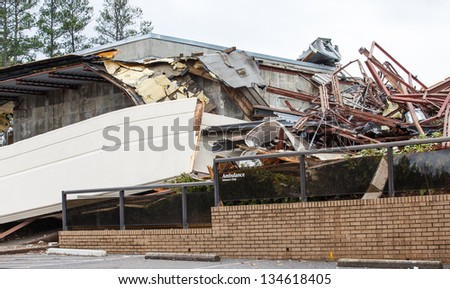 An emergency room building after demolition with Ambulance entrance sign intact - stock photo