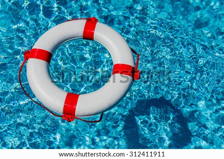 an emergency tire floating in a pool. symbolic photo for rescue and crisis management in the financial crisis and banking crisis. - stock photo