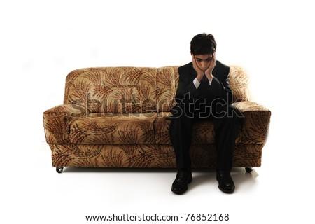 An emotional image of a teenage boy sitting alone - stock photo