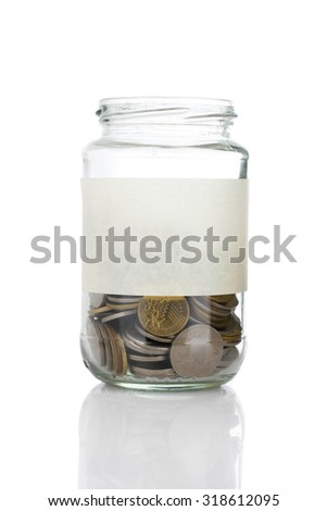 An empt text label on half coins of jar isolated on white background - saving, donation, financial, future investment and insurance concept - stock photo