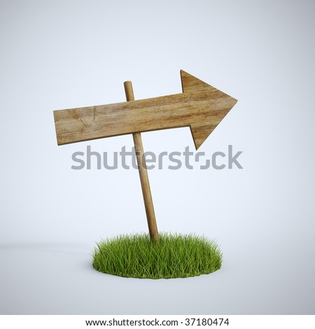 An empty arrow sign made out of wood on a patch of grass - stock photo