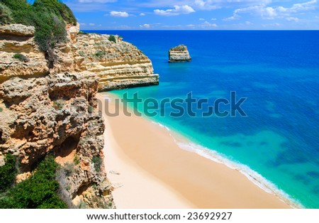 An empty beach in the Algarve, Portugal - stock photo