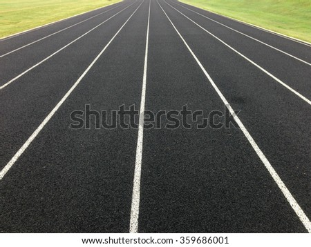 An empty black track with white lines