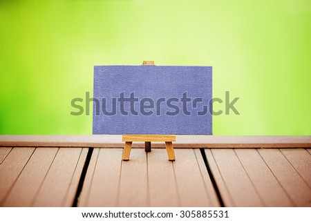 an empty blackboard with place for your text  on wooden board - stock photo