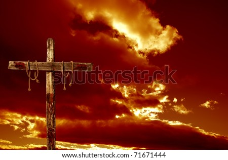 An empty bloody cross against a red cloudy sky representative of the immediate aftermath of the crucifixion of Jesus Christ