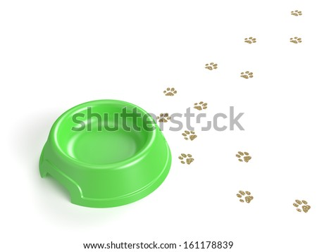 An empty bowl and cat's tracks isolated on white background with clipping path. - stock photo