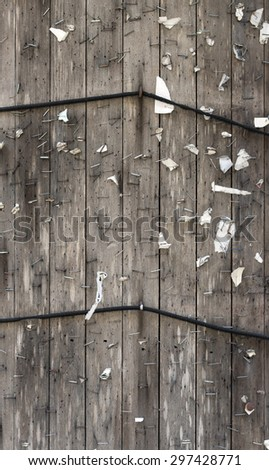 An empty bulletin board where the public may post announcements. Covered in rusty staples.  - stock photo