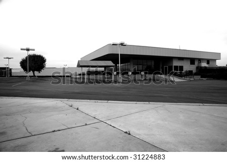 an empty car dealership  in black and white for impact state of the economy series - stock photo