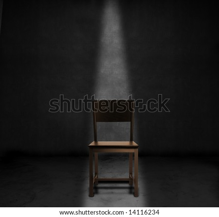 An empty chair and spotlight in a dark room - stock photo