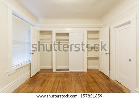 An empty closet in an empty studio apartment - stock photo