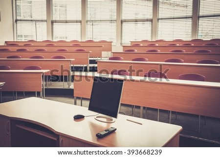 An empty college lecture hall in university. - stock photo