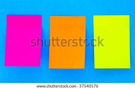 an empty color sticky notes on blue