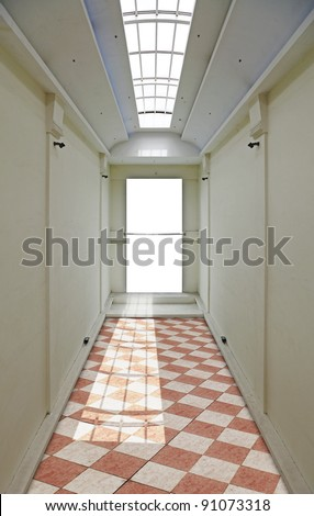 An empty display board with space for text at the end of an exhibition hallway with checkers floors and an open skylight. - stock photo