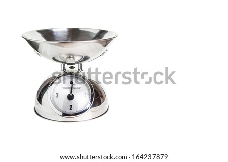 An empty food scale on a white background - stock photo