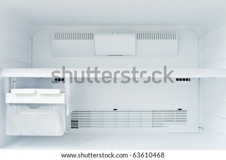 An empty freezer of a refrigerator - stock photo