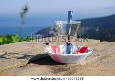 an empty glass with spoon