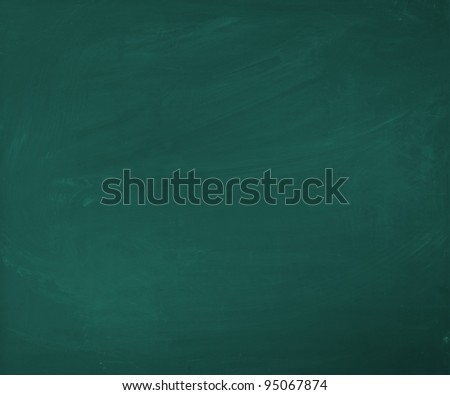 An empty green blackboard, a little bit dirty, for your own presentation - stock photo