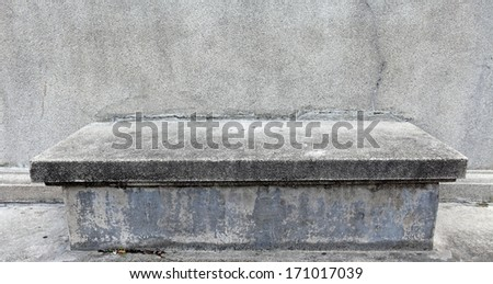 An empty grungy old stone altar.  - stock photo