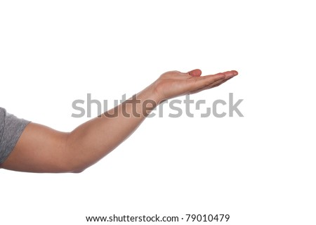 An empty hand being held out with lots of copy space for your text graphics or logo. - stock photo