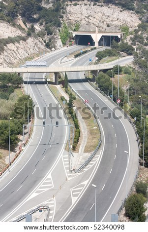 An empty highway (Autopista de Pau Casals, Barcelona, Spain). - stock photo