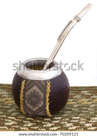 An empty mate cup from Argentina with a bomba/bombija. Earthy tones. - stock photo