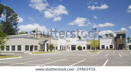 an empty mixed architectural style commercial mall - stock photo