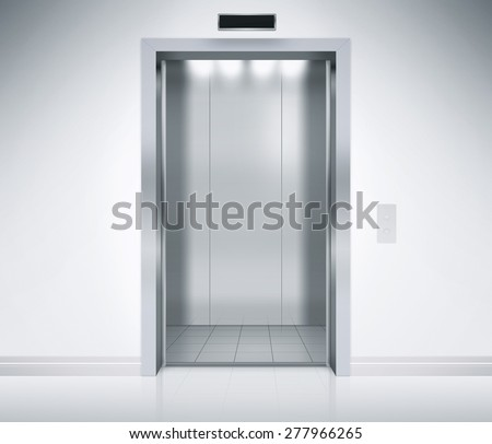 An empty modern elevator or lift with metal doors that are open in building with lighting. - stock photo