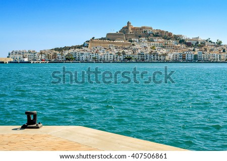 an empty mooring and the Mediterranean Sea, with Sa Penya and Dalt Vila districts, the old town of Ibiza Town, in the background, in the Balearic Islands, Spain - stock photo