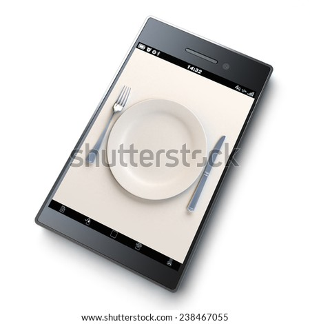 An empty plate with fork and knife on top of  a smart phone - stock photo