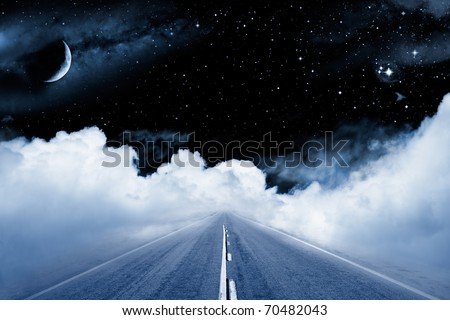 An empty road leading off into a surrealistic setting in outer space with stars and a crescent moon. - stock photo