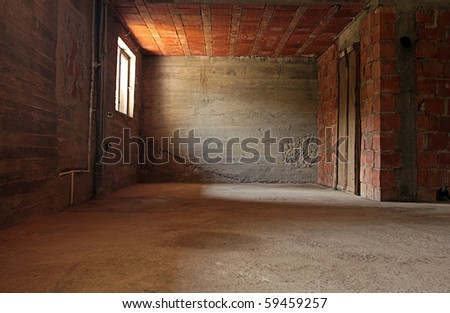 An empty room with brick walls and a window. - stock photo