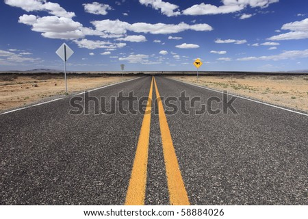 An empty rural highway in New Mexico, USA. - stock photo